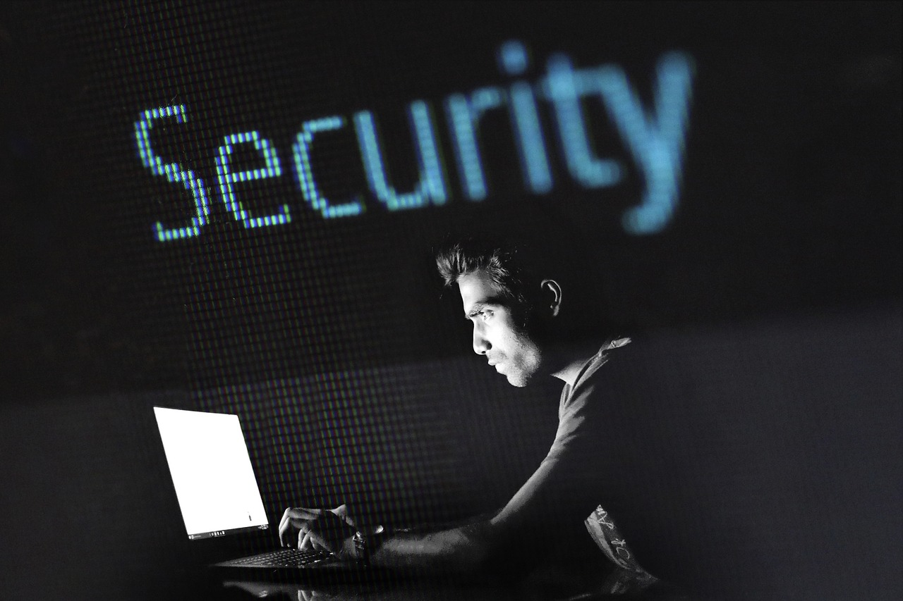 An image of a webmaster creating a secure website for a business.