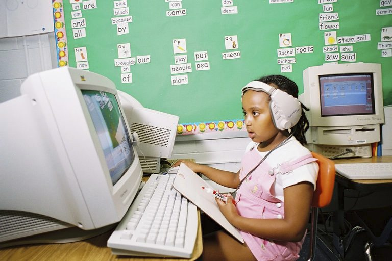 An image of a girl on a computer