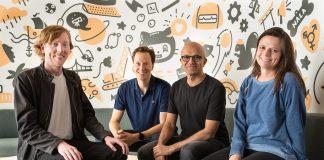 Satya Nadella with GitHub CEO and Microsoft officials