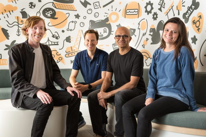 Satya Nadella with GitHub CEO and Microsoft officials